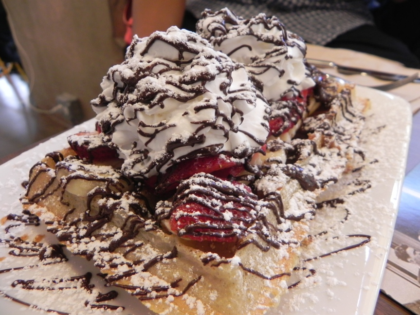 WMD brussels waffel with fixings - strawberries, banana, chocolate syrup, whipped cream, and dulce de leche ($ 8.00)